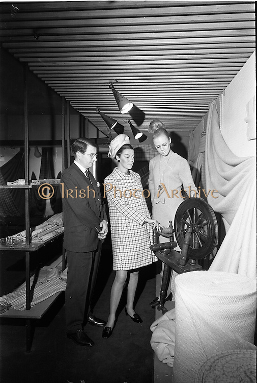 20/09/1967<br /> 09/20/1967<br /> 20 September 1967<br /> Gaeltarra Eireann Autumn 1967 Fashion Show at 34 Westland Row, Dublin. Michael O Flanagan, Marketing Manager, Tweeds, GaelTarra Eireann with Adrienne Ring (centre) wearing a Gaeltarra luxury tweed check coat in mink brown and white by Jimmy Hourihan and Anne Marie Berkeley wearing a lightweight Donegal handwoven tweed dress by Lomar.