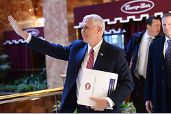 Vice President Elect Mike Pence waves to bystanders as he walks through lobby of the Trump Tower in New York, NY, on November 22, 2016. (Anthony Behar / Pool)