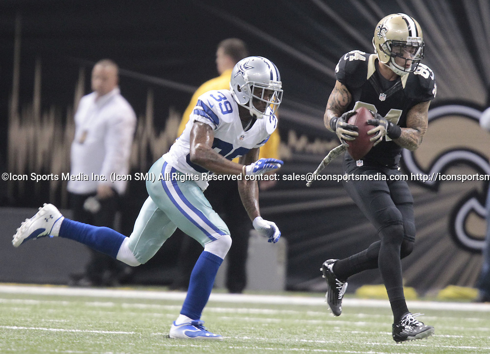 Nov. 10, 2013 - New Orleans, LA, USA - Kenny Stills (84) of the New Orleans Saints is chased by Brandon Carr of the Dallas Cowboys at the Mercedes-Benz Superdome in New Orleans on Sunday, Nov. 10, 2013