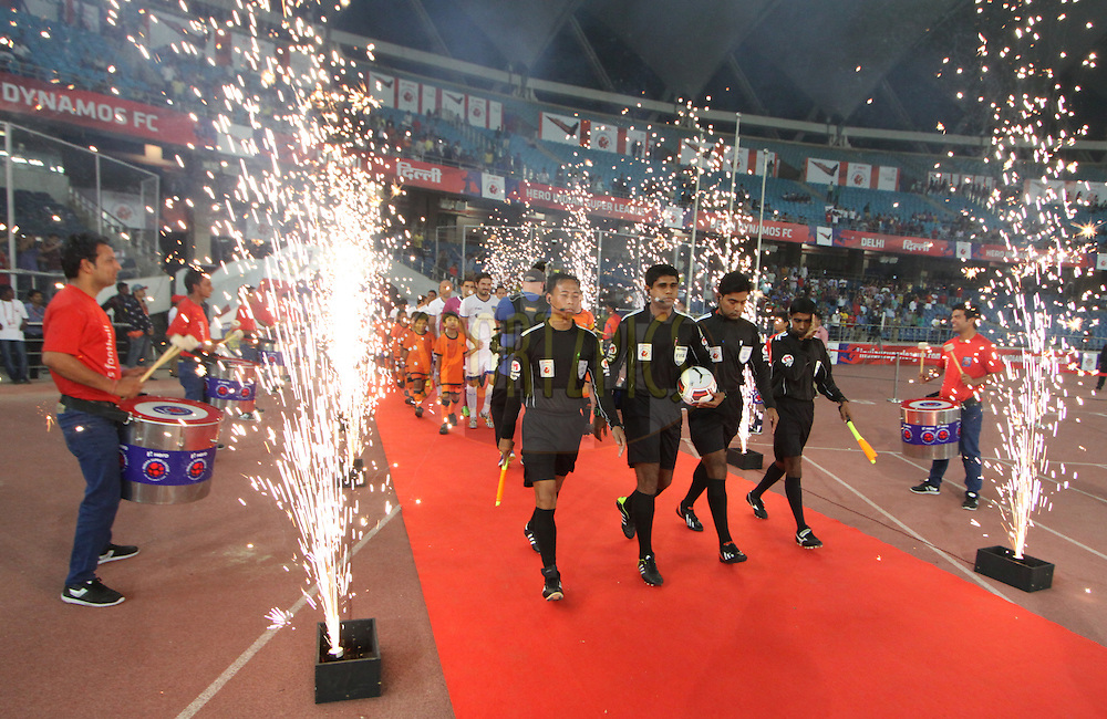 Match refree entring the field during match 12 of the Hero Indian Super League between The Delhi Dynamos FC and Chennaiyin FCheld at the Jawaharlal Nehru Stadium, Delhi, India on the 25th October 2014.<br /> <br /> Photo by:  Arjun Panwar/ ISL/ SPORTZPICS