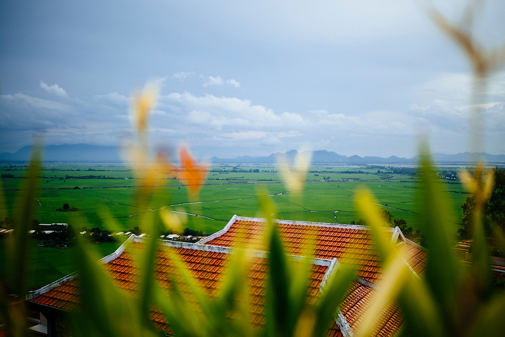A view over rice paddies and distant mountains from the Victoria Resort Nui Sam in Chau Doc, Vietnam.