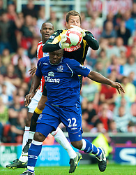STOKE, ENGLAND - Sunday, September 14, 2008: Everton's Ayegbeni Yakubu and Stoke City's goalkeeper Thomas Sorensen during the Premiership match at the Britannia Stadium. (Photo by David Rawcliffe/Propaganda)