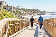 People Walking Over the Bridge on the San Clemente Beach Trail