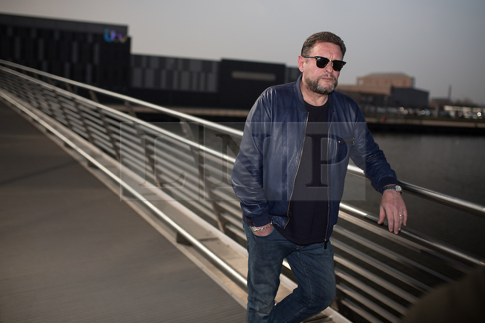 © Licensed to London News Pictures . 19/03/2015 . Salford Quays , UK . SHAUN RYDER at Salford Quays . Black Grape photocall at The Green , Salford Quays , Greater Manchester . Black Grape are reforming for a Madchester charity gig along with other local bands , to raise awareness for Bez's Reality Party and anti-fracking . Photo credit : Joel Goodman/LNP