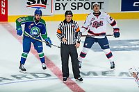 REGINA, SK - MAY 23: The referee prepares to drop the puck as Kole Gable #16 of the Swift Current Broncos and Scott Mahovlich #25 of the Regina Pats line up at the Brandt Centre on May 23, 2018 in Regina, Canada. (Photo by Marissa Baecker/CHL Images)