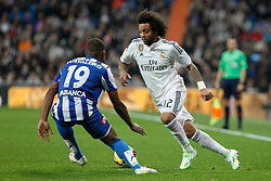 14.02.2015, Estadio Santiago Bernabeu, Madrid, ESP, Primera Division, Real Madrid vs Deportivo La Coruna, 23. Runde, im Bild Real Madrid&acute;s Marcelo Vieira (R) and Deportivo de la Courna&acute;s Cavaleiro // during the Spanish Primera Division 23rd round match between Real Madrid vs Deportivo La Coruna at the Estadio Santiago Bernabeu in Madrid, Spain on 2015/02/14. EXPA Pictures &copy; 2015, PhotoCredit: EXPA/ Alterphotos/ Victor Blanco<br /> <br /> *****ATTENTION - OUT of ESP, SUI*****