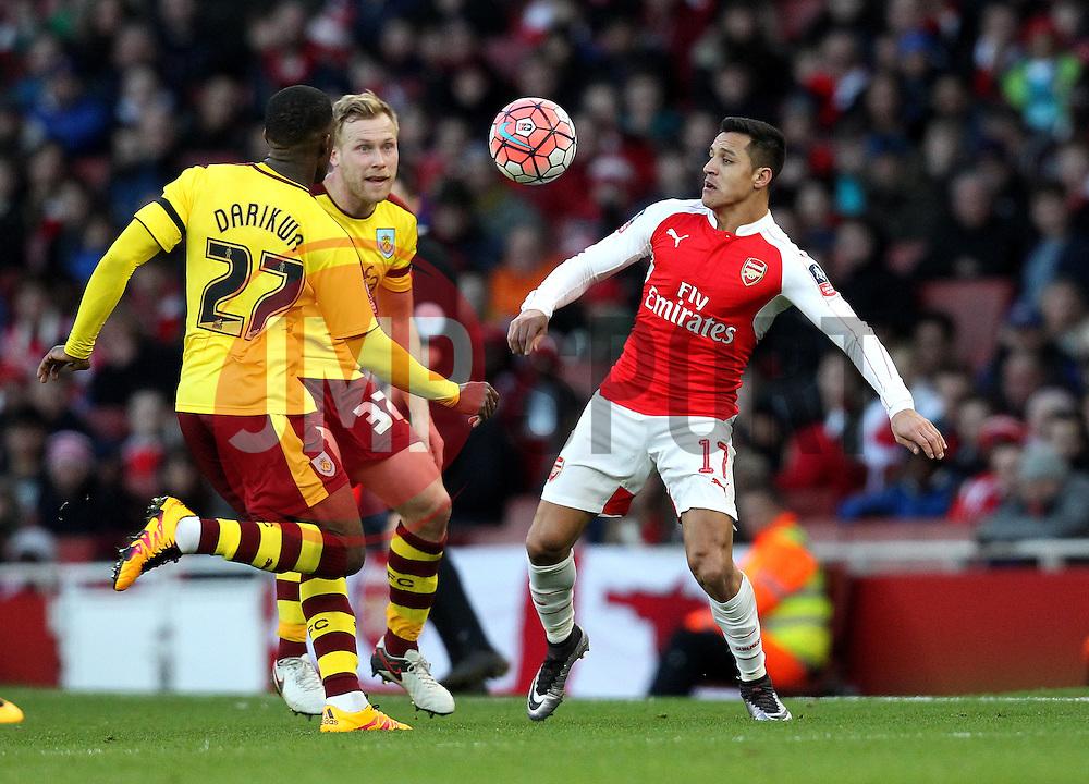 Alexis Sanchez of Arsenal controls the ball while Tendayi Darikwa of Burnley and Scott Arfield of Burnley apply pressure - Mandatory byline: Robbie Stephenson/JMP - 30/01/2016 - FOOTBALL - Emirates Stadium - London, England - Arsenal v Burnley - FA Cup Forth Round