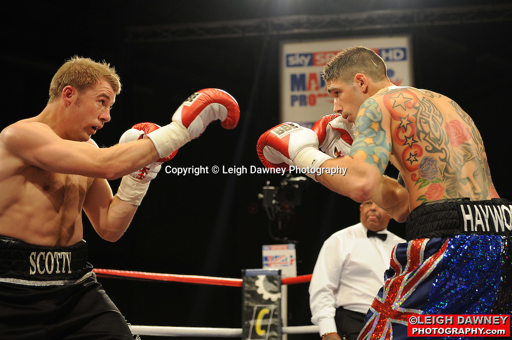 Scott Woolford (black shorts) defeated by Scott Haywood at Gorsebrook Leisure Centre Dagenham on 14th May 2010. Frank Maloney Promotions. Photo credit: © Leigh Dawney