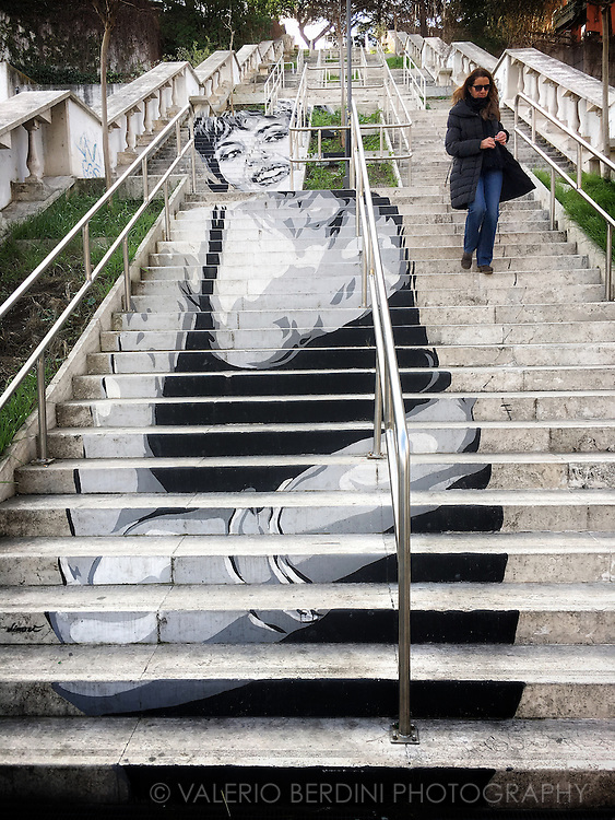 If the Spanish Steps are likely to be the most famous staircase in the world, these are unknown to most Romans. This mural can be seen in the northern area of Rome, on a stairway to Via Ronciglione off Corso Francia, a large noisy road that separates two upper middle-class neighbourhoods, Vigna Clara and Collina Fleming. The Graffiti artwork is by Diavù, depicts a portrait of the French actress Michèle Mercier who became famous in a Dino Risi movie.
