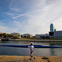 TAMPA, FL  -- Gyula Bela carries a boat out to row near the Tampa Bay Rowing Club on the University of Tampa campus near the Cass Street Bridge in Tampa, Florida. (Chip Litherland for Bay Magazine)