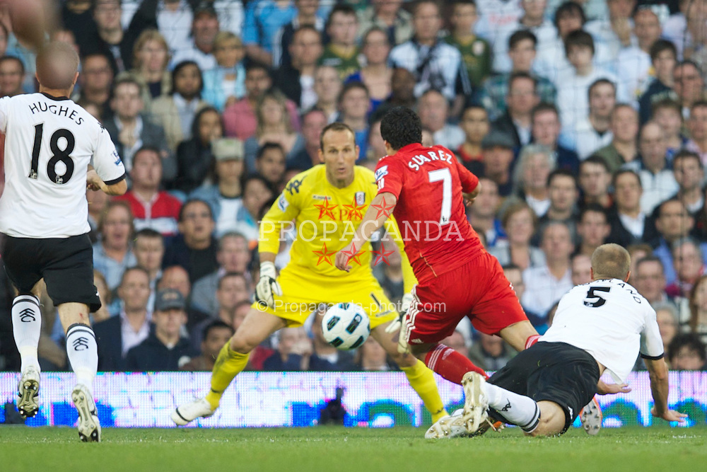 LONDON, ENGLAND - Monday, May 9, 2011: Liverpool's Luis Alberto Suarez Diaz is pushed over by Fulham's Brede Hangeland but no penalty is given during the Premiership match at Craven Cottage. (Photo by David Rawcliffe/Propaganda)