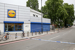 © Licensed to London News Pictures. 09/07/2019. London, UK. Crime scene outside Lidl store on Seven Sisters Road in Finsbury Park, north London following a stabbing at about 9.45pm on Monday 8 July 2019. Police officers found a 30 years old man suffering a knife wound and a second man, believed to be in his late twenties, was discovered with a gunshot injury in the nearby Blackstock Road. According to the police, the stab victim is in a stable condition. Photo credit: Dinendra Haria/LNP