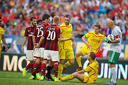 CHARLOTTE, USA - Saturday, August 2, 2014: AC Milan players surround Liverpool's Jordan Henderson during the International Champions Cup Group B match at the Bank of America Stadium on day thirteen of the club's USA Tour. (Pic by David Rawcliffe/Propaganda)