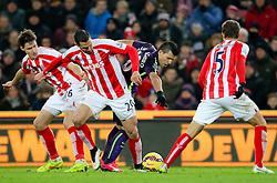 Manchester City's Sergio Aguero battles against the Stoke defence - Photo mandatory by-line: Matt McNulty/JMP - Mobile: 07966 386802 - 11/02/2015 - SPORT - Football - Stoke - Britannia Stadium - Stoke City v Manchester City - Barclays Premier League