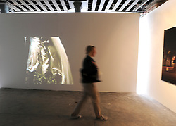 © licensed to London News Pictures. LONDON, UK.  22/06/11. Projections at the RCA graduate show. Students present their work at The Royal College of Art's Fine Art Graduate Show 2011. The show runs from 24th June-3rd July 2011. Mandatory Credit Stephen Simpson/LNP