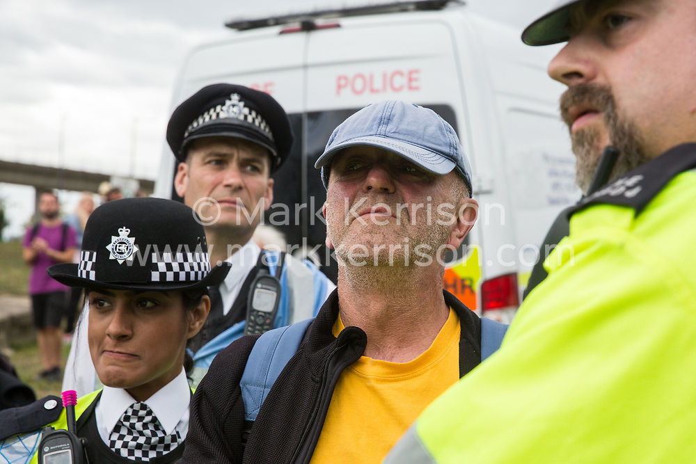 London, UK. 2 September, 2019. Police officers arrest an activist who had locked on using an arm tube to block a road outside ExCel London on the first day of week-long protests against DSEI 2019, the world's largest arms fair. The first day of creative action was hosted by activists calling for a ban on arms exports to Israel and featured workshops, speakers, street theatre and dance. Israeli arms companies display weapons at DSEI marketed as 'combat-proven' following deployment against Palestinian communities.
