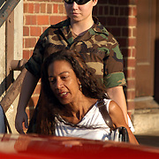 FORT BRAGG, NC- AUGUST 6: Pfc. Lynndie England (Center) leaves from a Friday's hearing with defense investigator Kathleen Johnson (R) at the Staff Judge Advocate Building on Fort Bragg in Fayetteville, NC on 8/6/04 for her Article 32 investigation hearing. England is charged with several counts, including one specification of conspiring to commit maltreatment of an Iraqi detainee, three specifications of assault against Iraqis, and several others. (Photo by Logan Mock-Bunting)