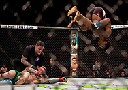 Galore Bofando (right) somersaults during his welterweight bout during the UFC Fight Night at the SSE Hyrdo, Glasgow.