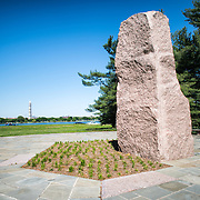 Main pink granite monument at the Lyndon Baines Johnson Memorial Grove. The memorial is set in Lady Bird Johnson Park on the banks of the Potomac on the George Washington Memorial Parkway in Arlington, Virginia. In the distance, across the Potomac, is the Washington Monument.