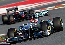 Motorsports / Formula 1: World Championship 2011, Testing in Barcelona, test, 07 Michael Schumacher (GER, Mercedes GP Petronas F1 ),   22 Narain Karthikeyan (IND, HRT F1 Team )