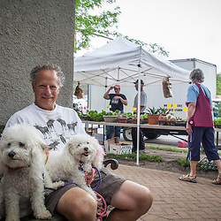 Waiting for his wife inside a restaurant at the Worthington farmer's market Saturday June 21, 2014. (Christina Paolucci, photographer).