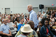 Former Vice President Joe Biden walks into the audience after learning that Felicia Sanders, the survivor of the AME church shooting was in the crowd during a town hall meeting at the International Longshoreman's Association Hall July 7, 2019 in Charleston, South Carolina.