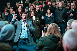 © Licensed to London News Pictures . 25/04/2019. Manchester, UK. STEPHEN YAXLEY-LENNON (aka Tommy Robinson ) announces he is running for a seat in the European Parliament in North West England at a barbecue event on a green on a housing estate in Wythenshawe , South Manchester . Photo credit: Joel Goodman/LNP