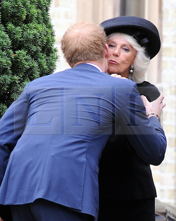 © Licensed to London News Pictures. 11/09/2013<br /> Camilla kissing Prince Harry after the service.<br /> Leaving the Cathedral after the Mass.<br /> Funeral for Hugh Van Cutsem at Brentwood Cathedral,Essex.<br /> Prince of Wales,Duke of Cambridge and Prince Harry in attendance today (11.09.2013)<br /> Photo credit :Grant Falvey/LNP