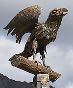 "Brass crow sculpture, Pontresina, in Upper Engadine, Switzerland, in the Alps, Europe. The Swiss valley of Engadine translates as the ""garden of the En (or Inn) River"" (Engadin in German, Engiadina in Romansh, Engadina in Italian)."