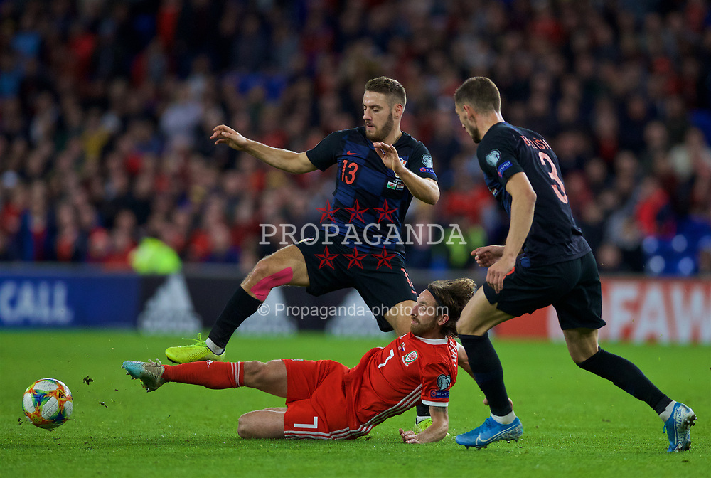 CARDIFF, WALES - Sunday, October 13, 2019: Wales' Joe Allen is fouled by Croatia's Nikola Vlašić during the UEFA Euro 2020 Qualifying Group E match between Wales and Croatia at the Cardiff City Stadium. (Pic by Laura Malkin/Propaganda)