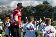 Philadelphia Eagles Carson Wentz QB (11) interacts wit the kids at the flag event during the press, training and media day for Philadephia Eagles at London Irish Training Ground, Hazelwood Centre, United Kingdom on 26 October 2018. Picture by Jason Brown.