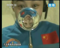59870560  <br /> This TV grab taken on June 20, 2013 shows female astronaut Wang Yaping, one of the three crew members of Shenzhou-10 spacecraft at the High School Affiliated to Renmin University of China, in Beijing, capital of China, June 20, 2013. A special lecture began Thursday morning, given by a teacher aboard China s space module Tiangong-1 to students on Earth, Thursday June 20, 2013.<br /> UK ONLY