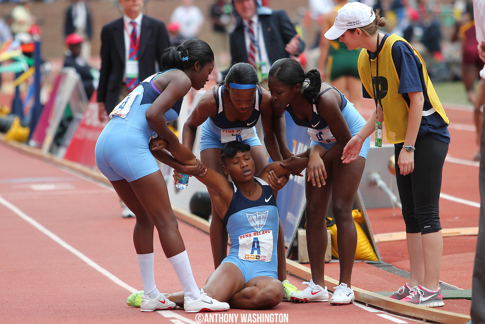 Ristananna Tracey of Edwin Allen High School in Jamaica falls to the ground after running a 2:03.17 split during the High School Girls' 4x800 Championship of America at the Penn Relays athletic meet on Friday, April 29, 2011 in Philadelphia, PA.<br />