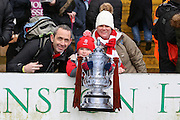Lincoln fans with replica FA Cup during the The FA Cup fourth round match between Lincoln City and Brighton and Hove Albion at Sincil Bank, Lincoln, United Kingdom on 28 January 2017. Photo by Phil Duncan.