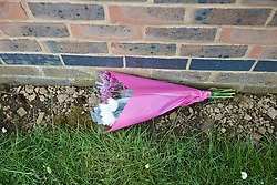 © Licensed to London News Pictures.  File pic dated 16/05/2013. BICESTER, UK. Flowers left at the scene where a two year old girl, who has been identified as 20-month-old Sarah Dahane, was found dead inside a house yesterday morning (Thursday). . Photo credit: Cliff Hide/LNP