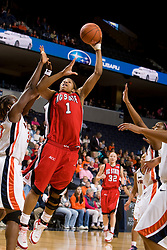 N.C. State forward Khadijah Whittington (1) shoots over Virginia center Aisha Mohammed (33).  The Virginia Cavaliers faced NC State Wolfpack women's basketball team at the John Paul Jones Arena in Charlottesville, VA on February 1, 2008.