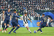 Juventus Forward Paulo Dybala shoots at goal past Manchester United Midfielder Ander Herrera who tackles during the Champions League Group H match between Juventus FC and Manchester United at the Allianz Stadium, Turin, Italy on 7 November 2018.