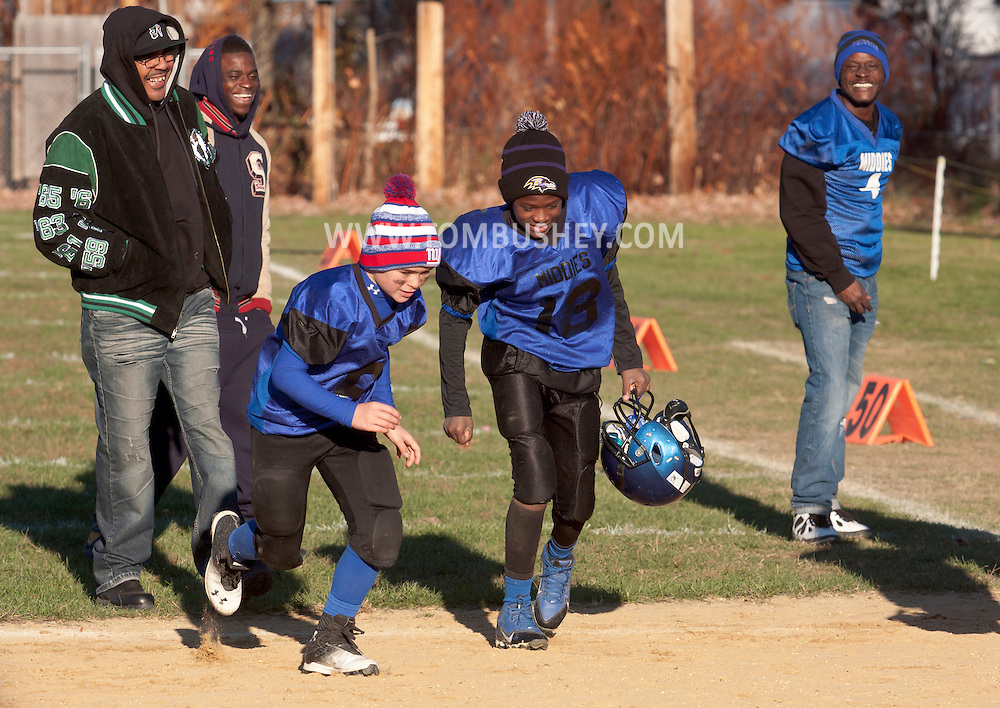 Middletown, New York - Middletown players run off the field after an Orange County Youth Football League Division II semifinal playoff game at Watts Park on Nov. 15, 2014.