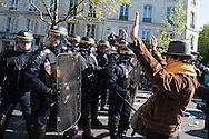 Place de la Nation, Paris, France. 1st May 2016. Hundreds of masked protesters clash with police in the Place de la Nation central Paris on May Day demonstrations. Pictured:   A protesters holds up his hands in front of a police line.   // Lee Thomas, Flat 47a Park East Building, Bow Quarter, London, E3 2UT. Tel. 07784142973. Email: leepthomas@gmail.com. www.leept.co.uk (0000635435)