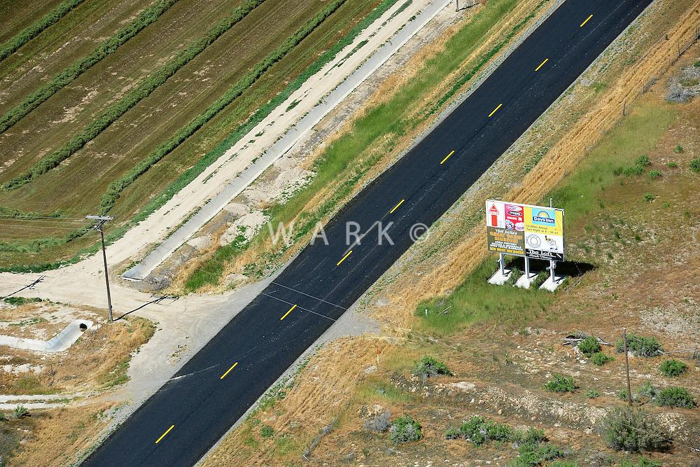 Billboard along new asphalt road