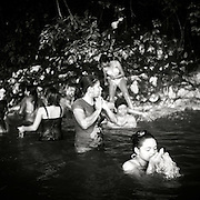 Schoolgirls bathe in hot springs in the Rio Dulce River in Guatemala.