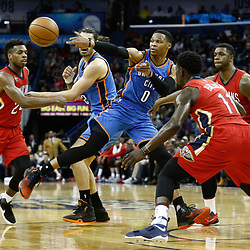 Dec 21, 2016; New Orleans, LA, USA;  Oklahoma City Thunder guard Russell Westbrook (0) passes as New Orleans Pelicans guard Jrue Holiday (11) and forward Terrence Jones (9) and guard Buddy Hield (24) defend during the first quarter of a game at the Smoothie King Center. Mandatory Credit: Derick E. Hingle-USA TODAY Sports