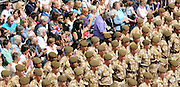 "The Troops marched up the High Street cheered by thousands who had come to watch. Shops stopped trading and staff came out on to the streets. Cheering and applause could be heard...Residents and visitors to Guildford will have the chance to welcome home troops from the 1st Battalion Princess of Wales's Royal Regiment next week when they march through the town centre following their return from Iraq and Afghanistan...The Homecoming Parade, organised by Guildford Borough Council, will take place on Wednesday 15 July.  Around 200 soldiers from the local Regiment, also known as 'The Tigers', will set off from Millmead and parade through Guildford with the Kohima Band of the 3rd Battalion.  The Mayor of Guildford will host a reception at Holy Trinity Church for the troops, veterans and cadets...    Says Mayor of Guildford, Cllr Pauline Searle: ""Guildford warmly welcomes the 1st Battalion Princess of Wales's Royal Regiment home.  The Regiment has been historically associated with Guildford for many years and the troops are now in a position to exercise the Freedom of the Borough transferred to them in 1992.  We hope as many people as possible will come along to watch the parade and celebrate this special occasion""...    Queen's Royal Surrey Regiment veteran Kenneth Honeyman, 93, adds: ""As a younger man I always attended the 5th Queen's Members' Association Open Days and marched through Guildford.  The parade will give me the opportunity to meet up with the few surviving old members and pay tribute to the soldiers who serve our country today""...The salute will be taken by Guildford born and bred Colonel Patrick Crowley, the Vice-Lord Lieutenant Gordon Lee-Steere DL, and the mayor.  Two soldiers will be presented with medals by the mayor during the parade.  Private Bill Maguire, 18, from Guildford, who has served with the Battalion for two years will be awarded an operational tour medal for service in Iraq.  Following six years' service with the Battalion, Lance Corporal Ky"