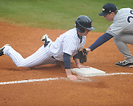 Ole Miss' Austin Anderson (8) is safe at third vs. UT-Martin at Oxford-University Stadium in Oxford, Miss. on Wednesday, February 20, 2013. Ole Miss won 15-2 to improve to 4-0.