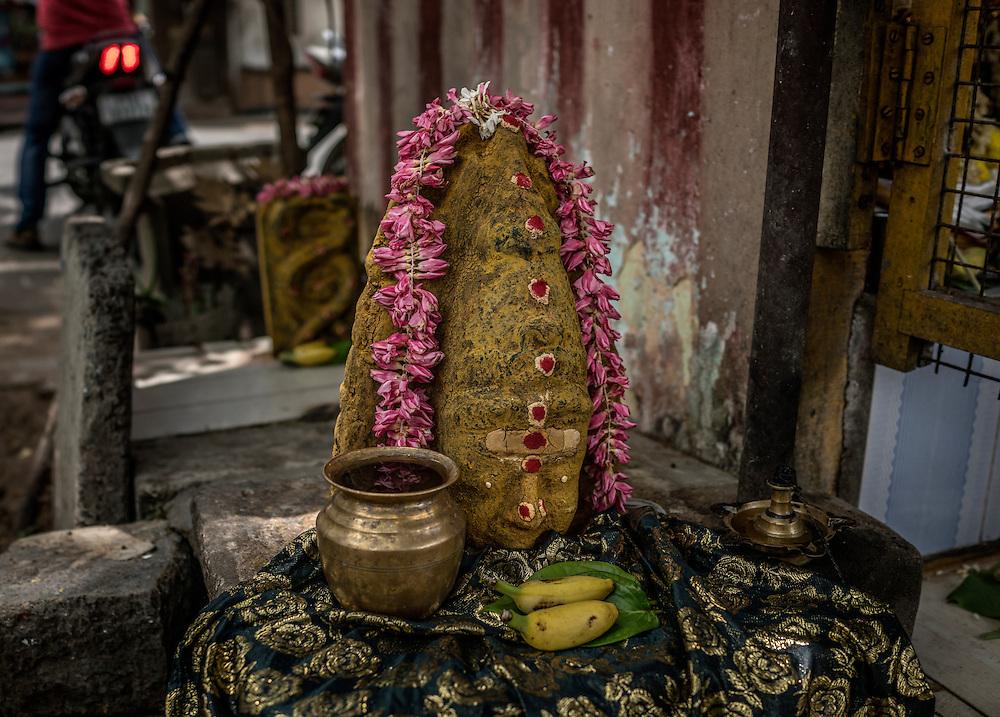 Hindu religious stone, called Mundakanni Amman (Big Eyes Goddess) at a small shrine in Pondicherry, India.