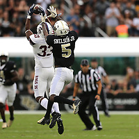 ORLANDO, FL - SEPTEMBER 08:  Chris Adams #33 of the South Carolina State Bulldogs intercepts the ball in front of Dredrick Snelson #5 of the UCF Knights during a football game at Spectrum Stadium on September 8, 2018 in Orlando, Florida. (Photo by Alex Menendez/Getty Images) *** Local Caption *** Chris Adams; Dredrick Snelson