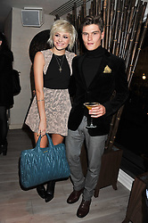 PIXIE LOTT and OLIVER CHESHIRE at a party to launch Senkai - London's first modern Japanese-inspired restaurant at 65 Regent Street, London on 26th October 2011.