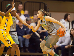 Jan 30, 2016; Morgantown, WV, USA; Baylor Bears guard Alexis Prince (12) dribbles the ball during the first quarter against the West Virginia Mountaineers at WVU Coliseum. Mandatory Credit: Ben Queen-USA TODAY Sports