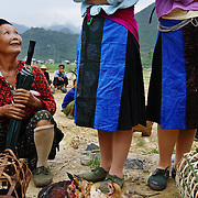 An elderly woman talks with friends at an open air market in Ha Giang, Vietnam's northernmost province, 06 June, 2007. As cities like Hanoi and Ho Chi Minh roar with Vietnam's economic boom, Ha Giang remains a quiet, serene and beautiful mountain backwater along the Chinese border.