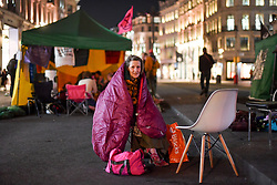 © Licensed to London News Pictures. 19/04/2019. London, UK.  Extinction Rebellion protesters camp overnight for the fifth day at Oxford Circus in central London, blocking traffic on Regents Street and Oxford St. The boat which featured as a centre piece and makeshift stage for Emma Thompson amongst others campaigning climate change, was dismantled and removed by police during afternoon. Its removal did little to dampen spirits of campaigners who were permitted to remain in the face of a large police presence. Photo credit: Guilhem Baker/LNP